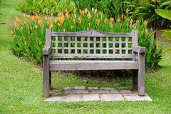 Brown bench in garden Royalty Free Stock Image