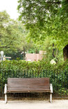 Brown bench with nobody in the park Royalty Free Stock Photo