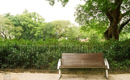 Brown bench with nobody in the park Royalty Free Stock Images