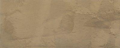 Brown-Beschaffenheit des Gipses, dekorative Beschichtung für Wände in der Makrophotographie Lizenzfreies Stockbild