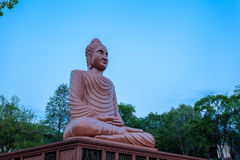 Brown big Buddha Khmer art at Wat Phou Wa Stock Images