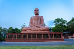 Brown big Buddha Khmer art at Wat Phou Wa Stock Photos