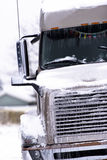 Brown big modern semi truck in snow and ice Royalty Free Stock Image