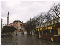 Brown Bigbus Istanbul Traveling on Road Near Brown Dome Building Stock Photos