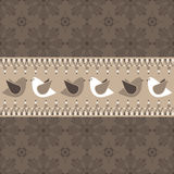 Brown birds. Seamless decorative background with brown bird banner Royalty Free Stock Photo