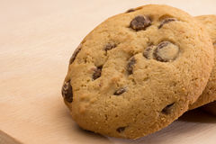 Brown biscuits cookies with chocolate parts Stock Photography