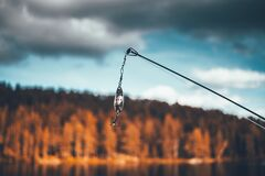 Brown Black Fishlure on Rod Selective Focus Photography Royalty Free Stock Photo