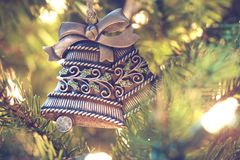 Brown Black Floral Carve Bell Hanging on a Christmas Tree Royalty Free Stock Photo