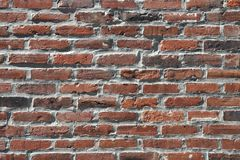 Brown black gray old brick wall Royalty Free Stock Image