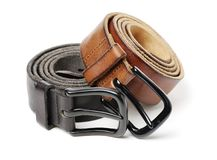 Brown and black leather belt with metal sliver belt-buckle. Isolated on white background royalty free stock photography