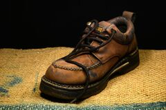 Brown and Black Leather Work Boots on Brown Surface Royalty Free Stock Photography