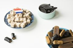 Various Dutch licorice candy on white table royalty free stock photos
