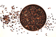 Brown and black rice. On the white Stock Photo