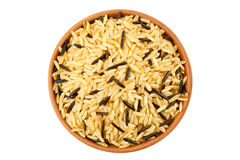 Brown and black rice in ceramic bowl on white Royalty Free Stock Photography