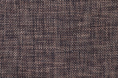 Brown and black textile background closeup. Structure of the fabric macro Royalty Free Stock Photography