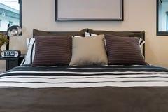 Brown, black and white striped pillows Stock Photos