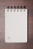 Brown blank note book on wood Stock Images