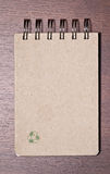 Brown blank note book on wood Royalty Free Stock Images