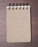 Brown blank note book on wood Stock Photos