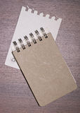 Brown blank note book on wood Royalty Free Stock Photos