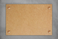 Brown blank paper on gray concrete wall. Royalty Free Stock Photo
