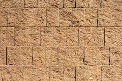 Brown-Block-Wand für Hintergründe oder Beschaffenheiten Stockbilder