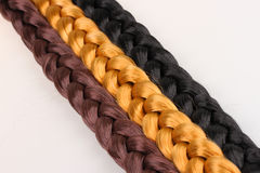 Brown,blond and black hair braid Royalty Free Stock Photo