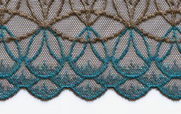 Brown and blue flowers lace material texture macro shot Stock Photo