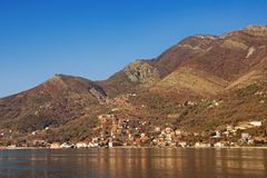 Brown and blue landscape. Bay of Kotor, Montenegro. Free space for text. Brown and blue landscape with mountains on the seashore.  Bay of Kotor Adriatic Sea Royalty Free Stock Image