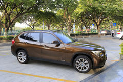 Brown bmw x1 sdrive 18i car Royalty Free Stock Photos
