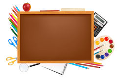 Brown board with school supplies. Royalty Free Stock Photography