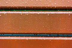 Brown boards covered with raindrops royalty free stock photography