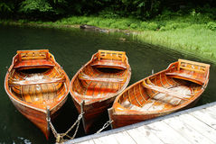 Brown boats on the lake in summer stock photo