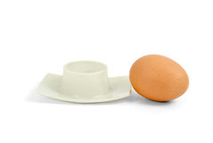 Brown boiled egg near eggcup Stock Photo