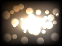 Brown bokeh background. Dark brown defocused light, flickering lights. Royalty Free Stock Image