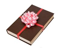 Brown book and bow Royalty Free Stock Photos