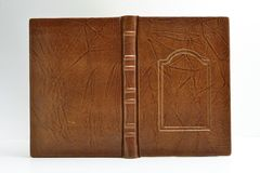 Brown book cover bound in leather with wrinkles all around the surface captured opened and isolated stock photos