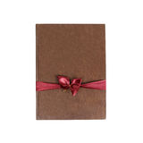 Brown book gift. With red ribbon and bow. Isolated. On a white background Stock Image
