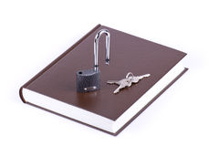Brown book, key and padlock Stock Photo
