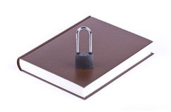 The brown book and padlock Stock Images
