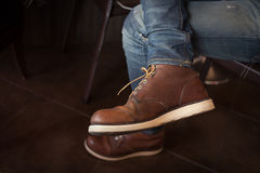 Brown boot leather shoes and jean pants Royalty Free Stock Images