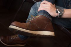 Brown boot leather shoes and jean pants clothing fashion Royalty Free Stock Photo