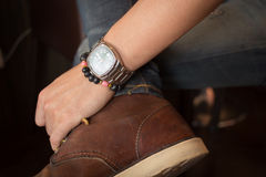 Brown boot leather shoes and jean pants clothing fashion Stock Photo