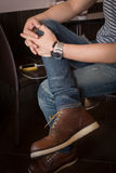 Brown boot leather shoes and jean pants clothing fashion Royalty Free Stock Image