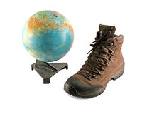 Brown boot next to a globe Royalty Free Stock Images