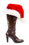 Brown boot with santa hat Stock Image