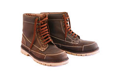 Brown boots. On white background Royalty Free Stock Photos