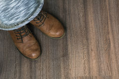 Brown boots with grey hat Royalty Free Stock Photo