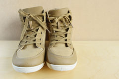 Brown boots on wooden background. Royalty Free Stock Image