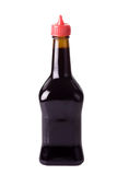 Brown bottle. With soup flavour isolated on white background stock photos